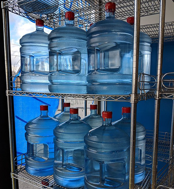 water jugs on rack, drinking water, clean water