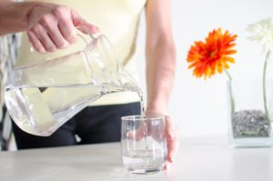 Woman pouring water into glass