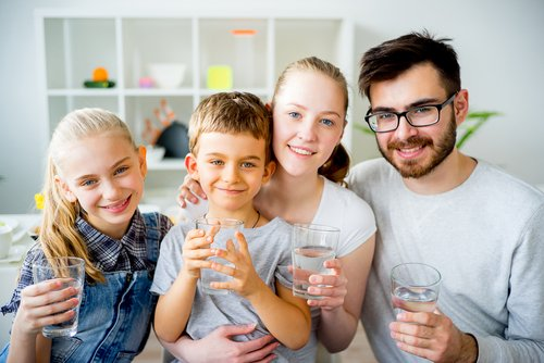 happy family drinking water